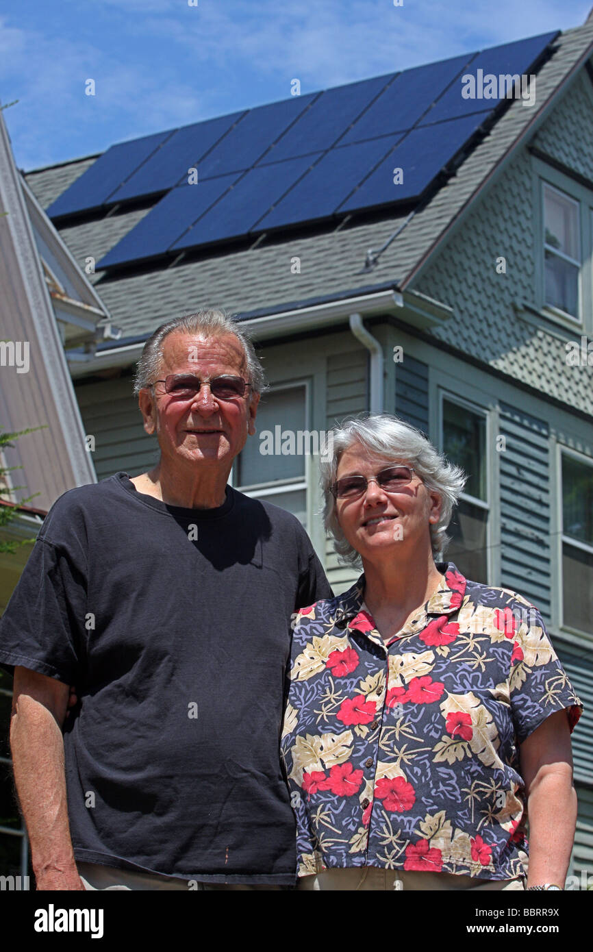Connecticut USA homeowners with solar panels on their roof - Stock Image