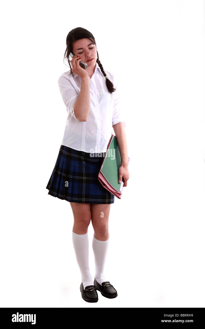 Mixed Race Teen School Girl On Her Cell Phone Stock Photo