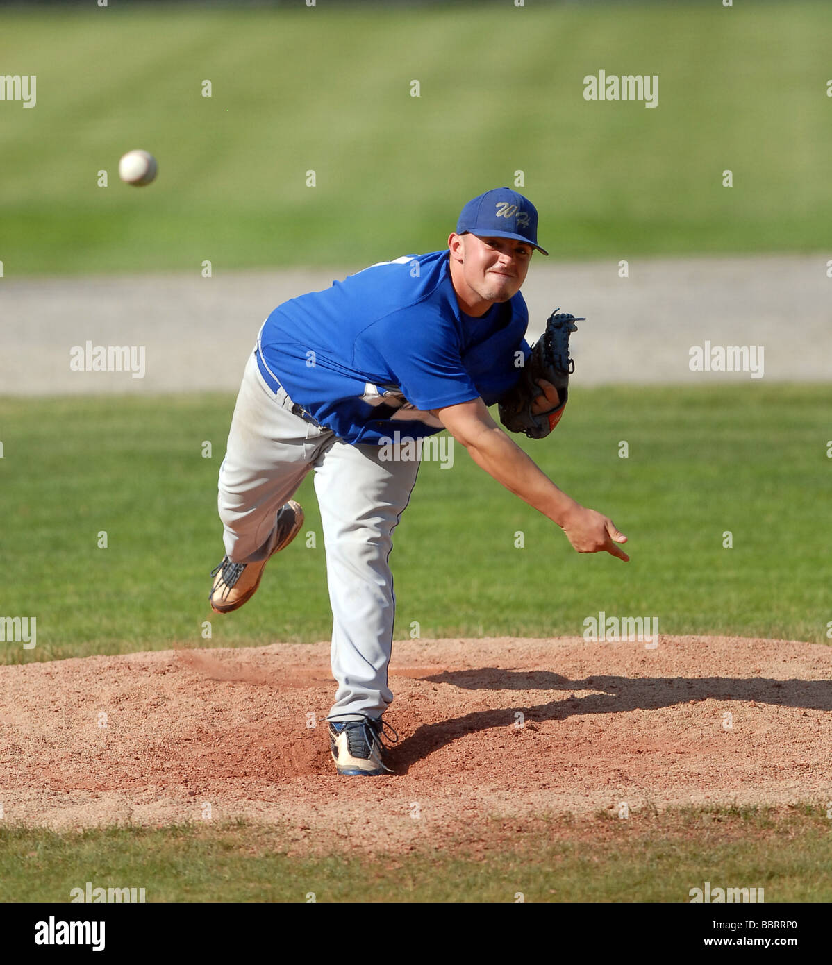 High school pitcher throwing ball during State Championship baseball game in CT USA - Stock Image