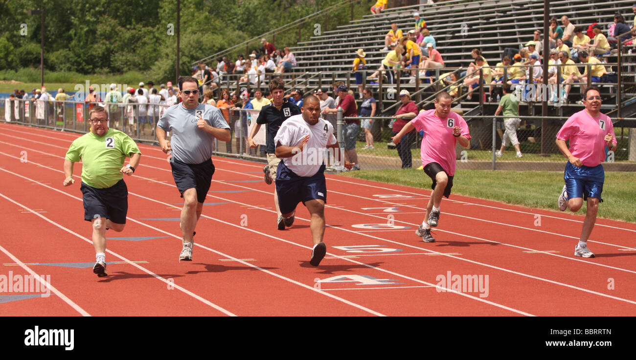 Special Olympics runners race in the 100 meter track event in New Haven CT USA - Stock Image