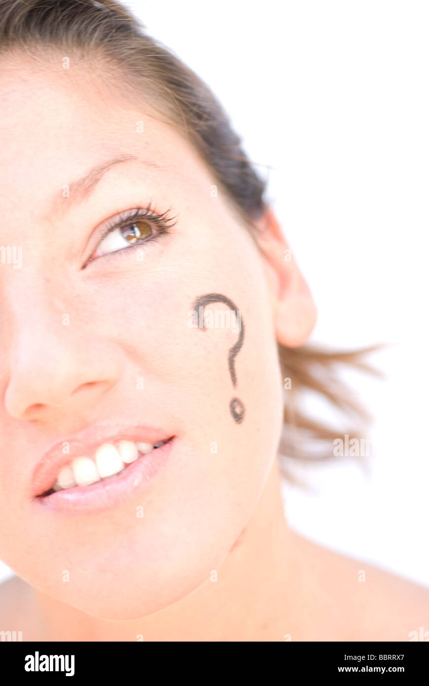 Question mark simbol painted in woman´s face and thinking on answer - Stock Image