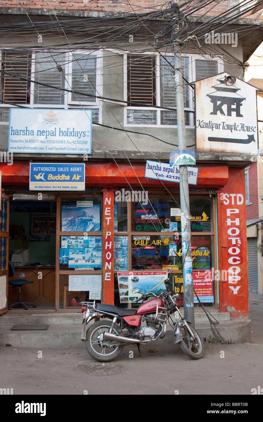 Kathmandu, Nepal.  Street Scene, Motorcycle in front of Travel Agency. - Stock Image