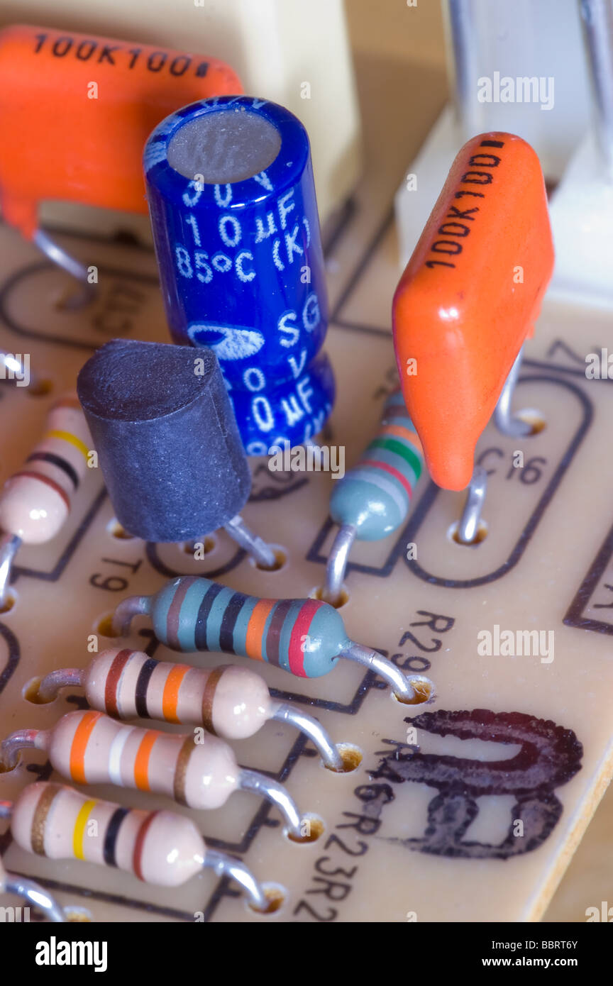 Electronic circuit board with several components including resistors and capacitors - Stock Image