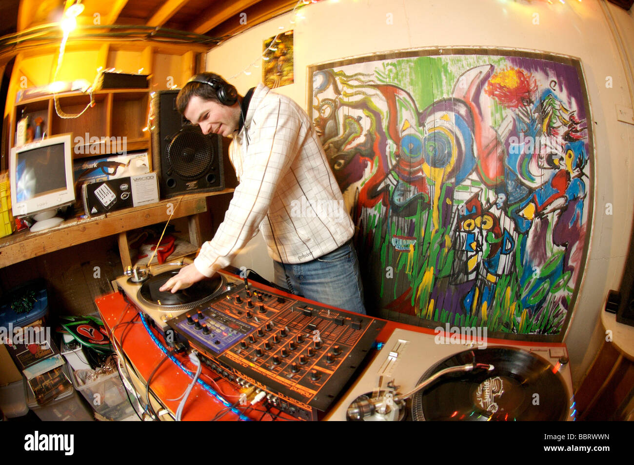 A Disk Jockey spins records at a night club - Stock Image