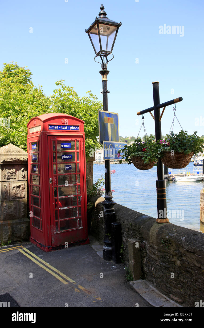 An old telephone box modernised to offer email text and phone service to the public - Stock Image