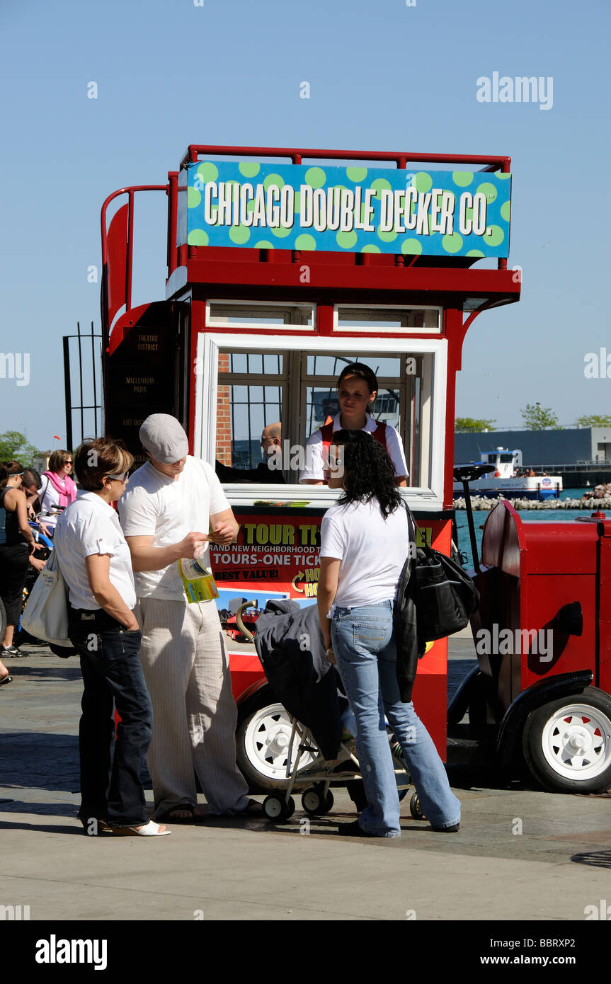 Tourists buying tickets for a Chicago city bus tour - Stock Image