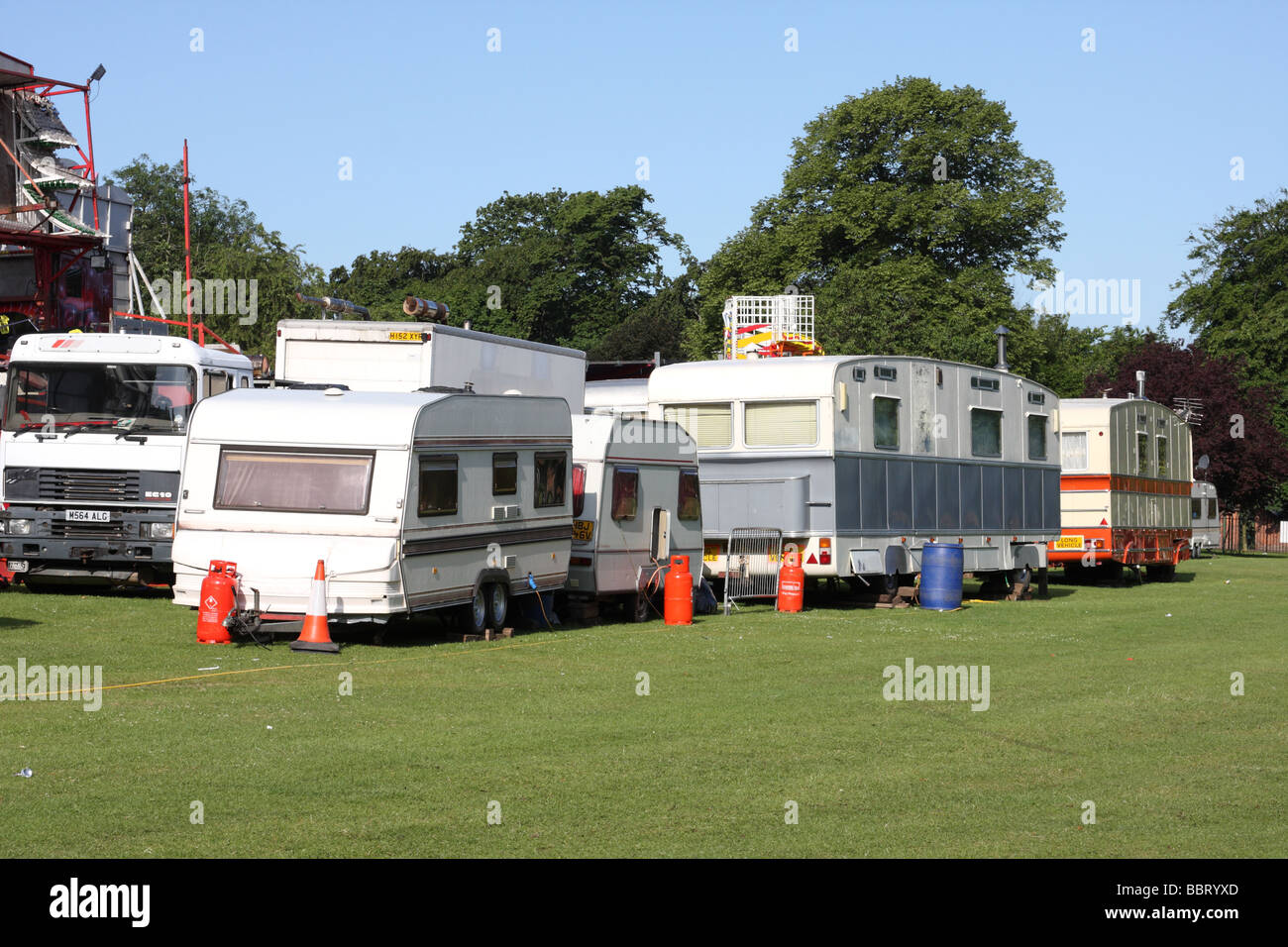 Showmans caravans at a travelling funfair in the U.K.. - Stock Image
