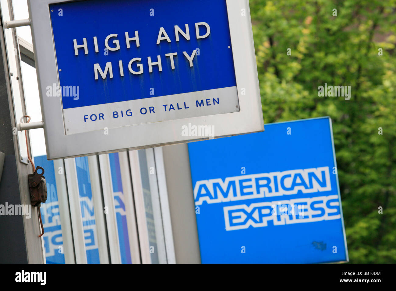 High and Mighty and American Express Logos on High Street Shops - Stock Image