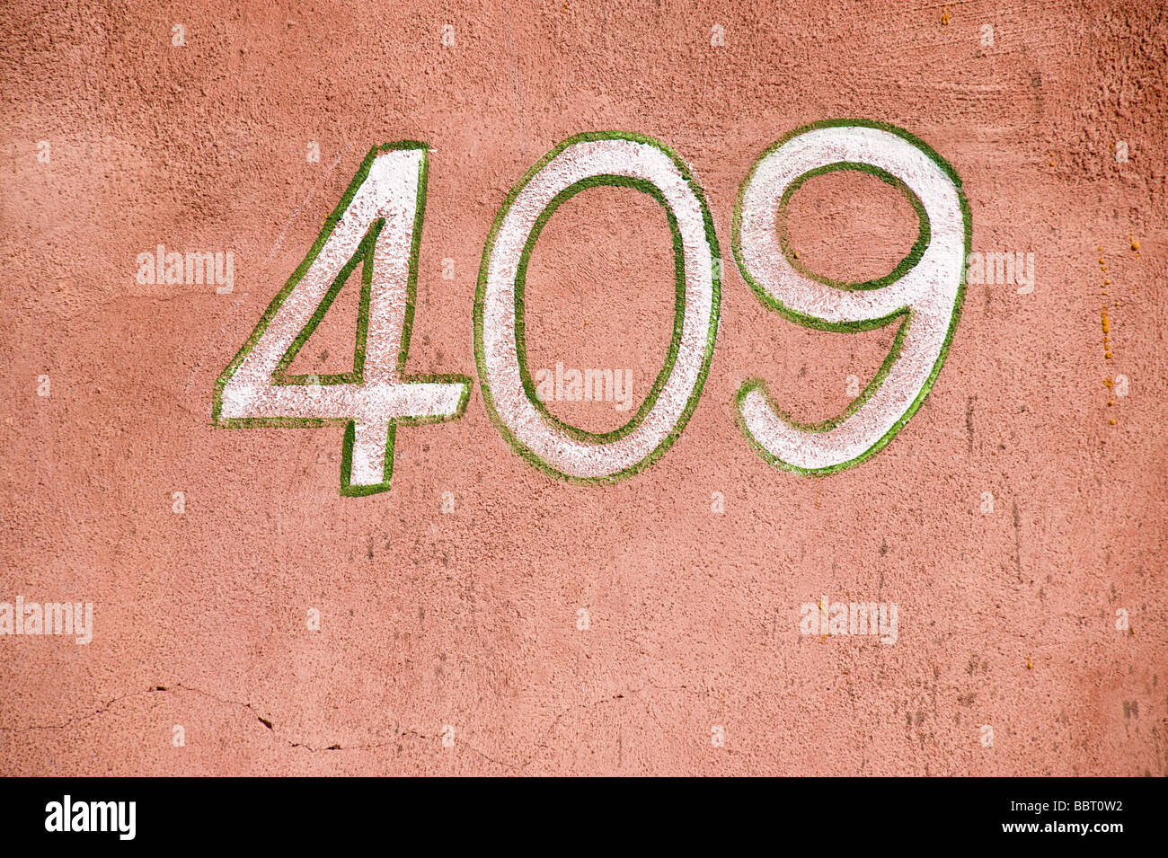 Address on an old adobe wall in Carrizozo, New Mexico. - Stock Image