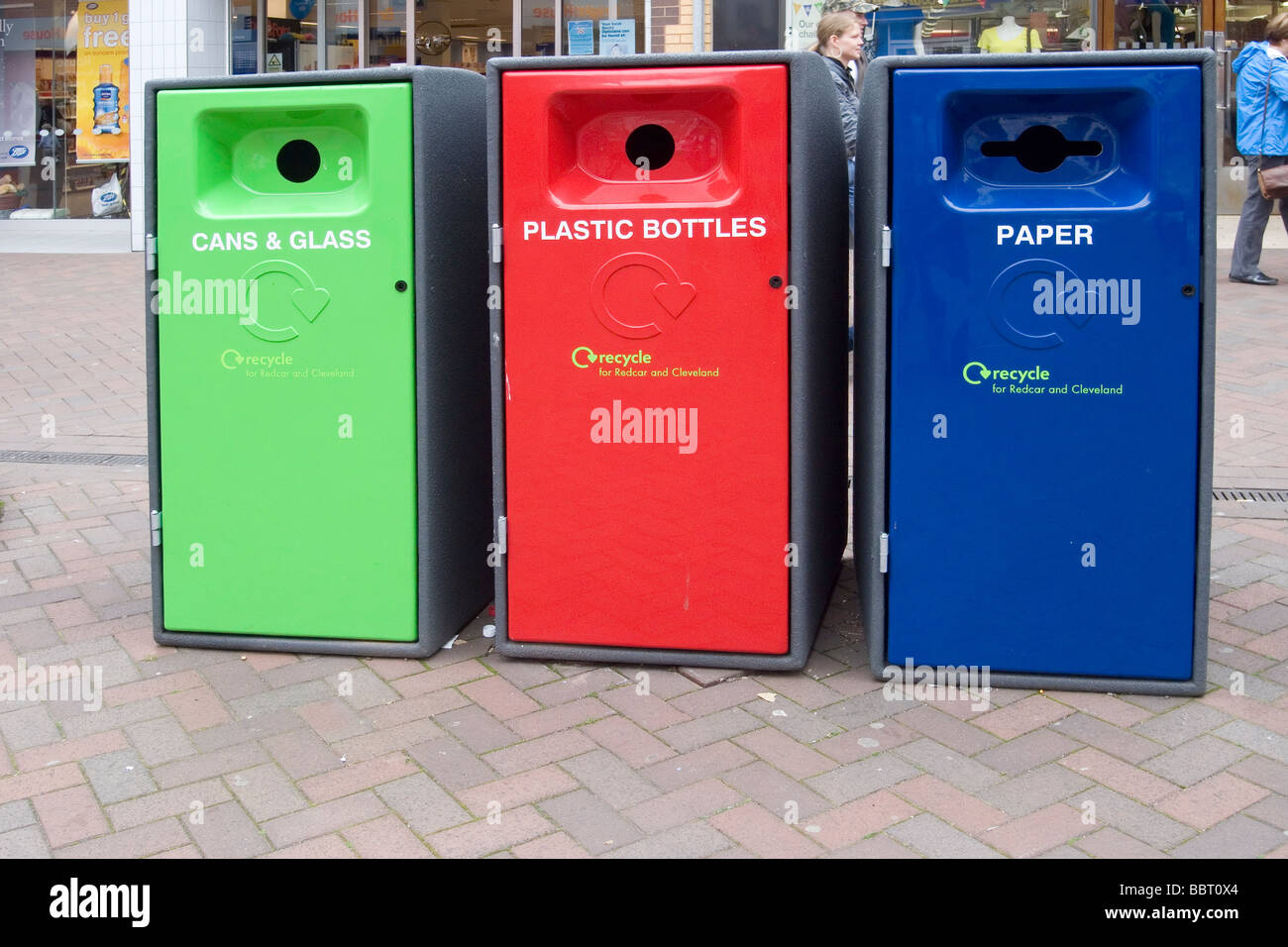 Smart new recycling bins for cans and glass plastic bottles and paper in Redcar town centre Stock Photo