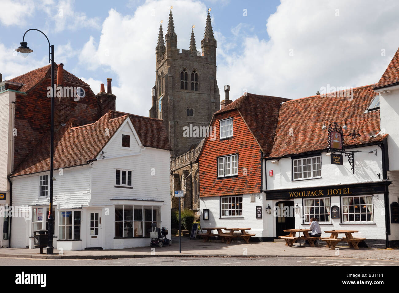 The Woolpack hotel 15th century pub and St Mildred's Parish Church clock tower in Wealden village of Tenterden - Stock Image