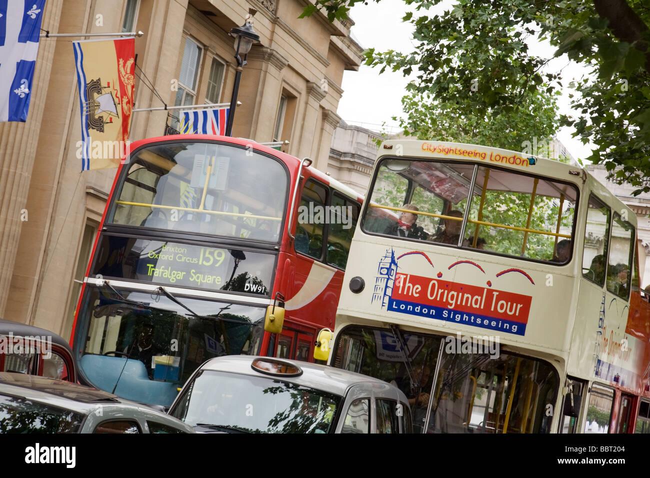 An 'Original Tour'  bus, and a London double decker bus,  London, UK - Stock Image