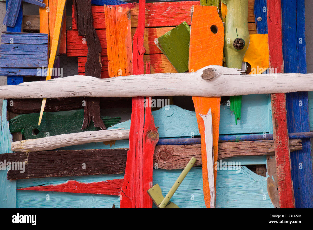 Colorful three dimensional art on an outside wall, in Carrizozo, New Mexico. - Stock Image