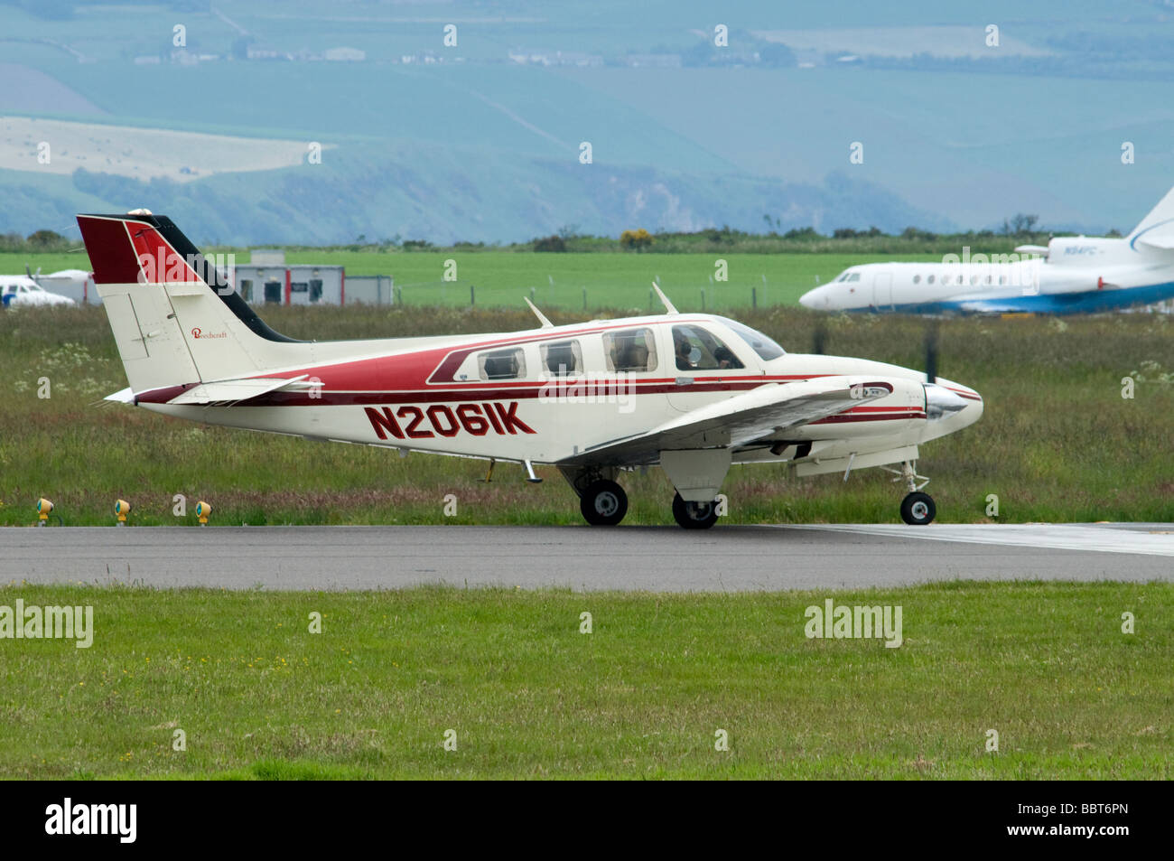BEECH 58P BEECH 58P light twin engined piston propellor driven aeroplane at Inverness Airfield Scotland      SCO - Stock Image