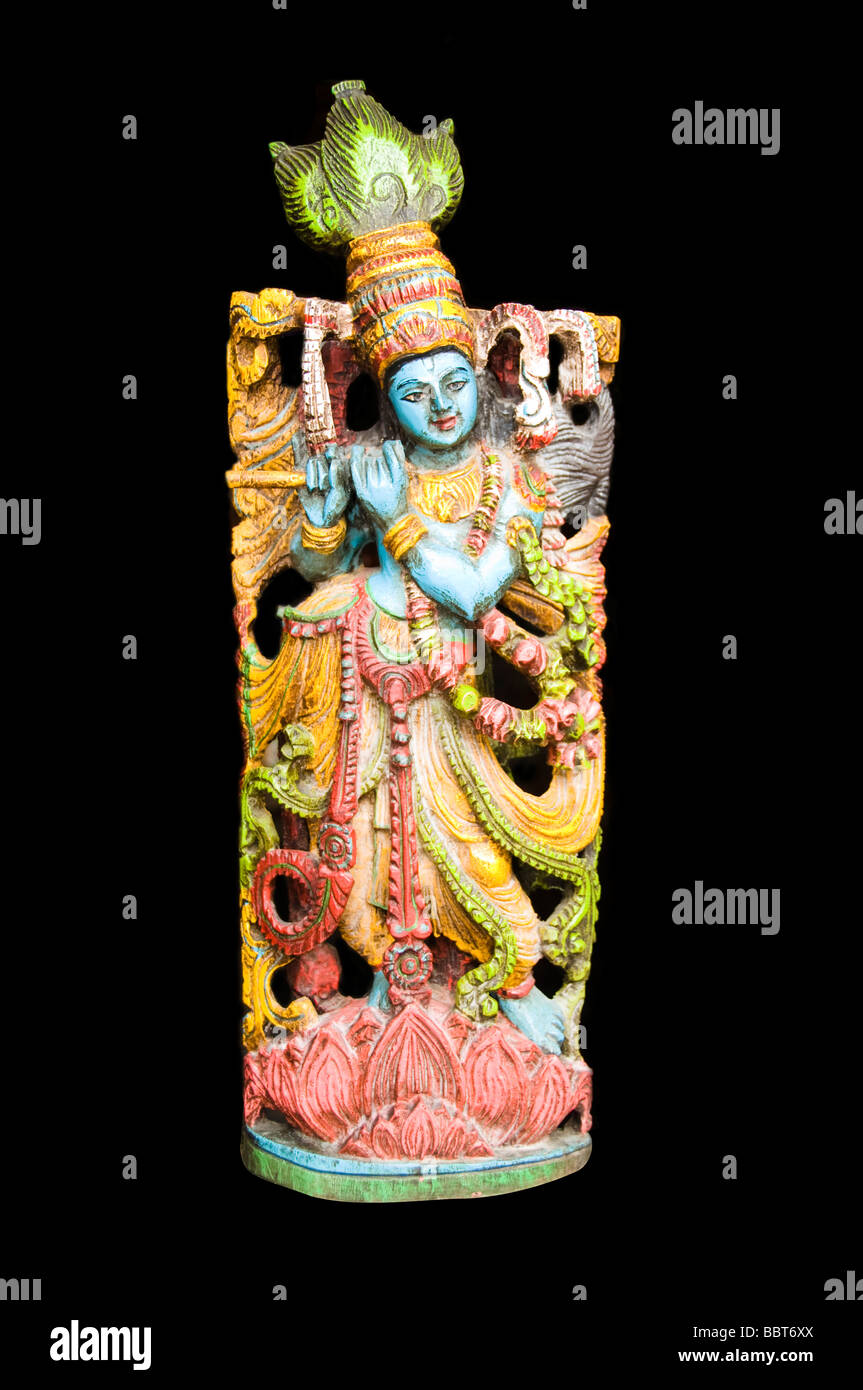 Hindu deity krishna playing flute - Stock Image