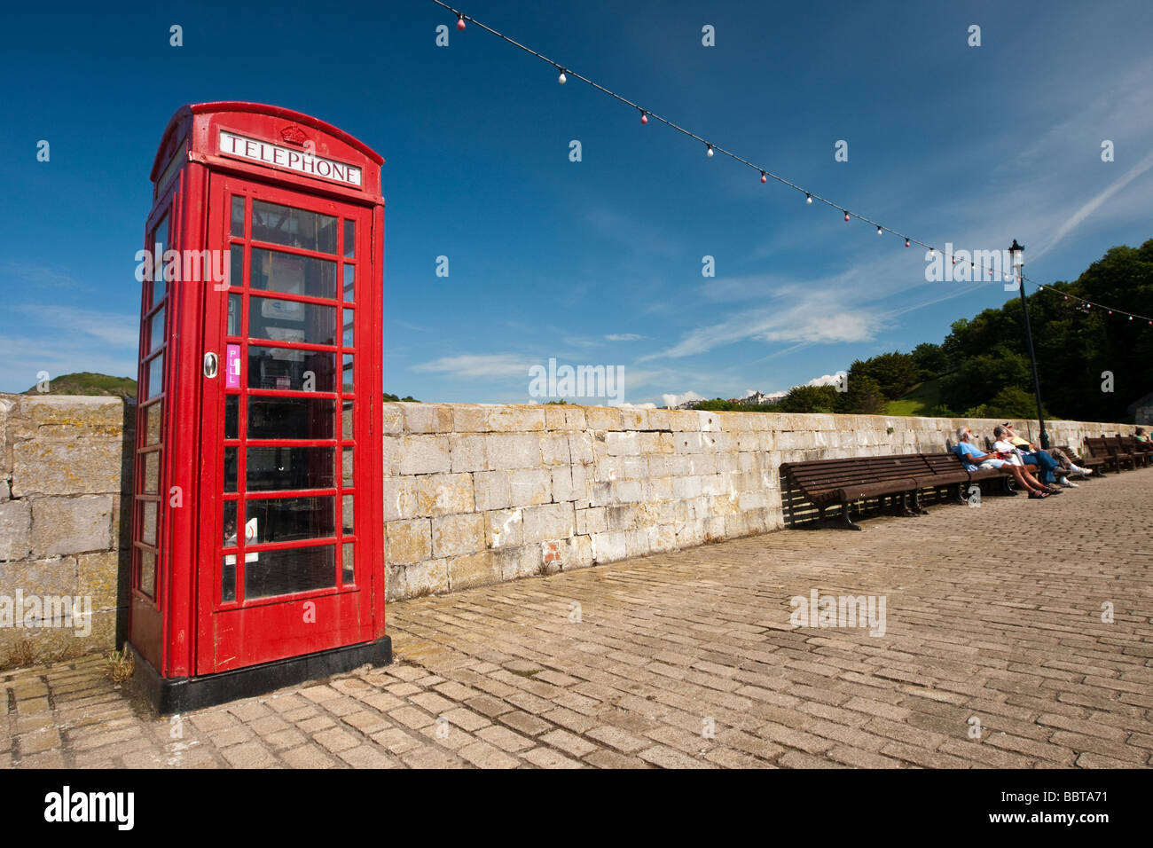 Red British Telephone Box in Ilfracombe Harbour, Devon, England - Stock Image