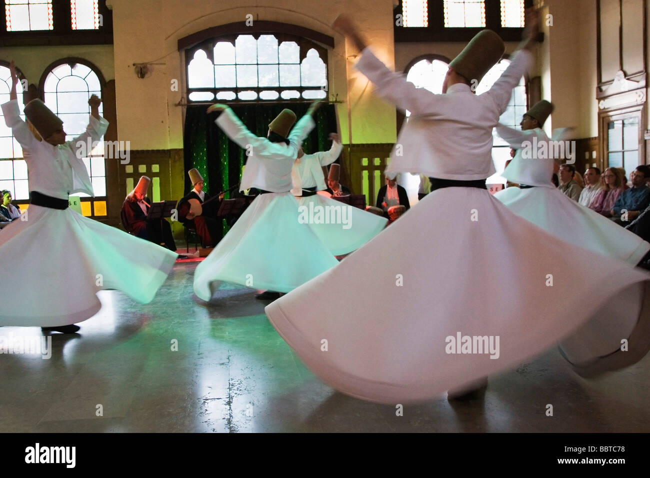 Mevlana Whirling Dervishes perform Sema, Sirkeci Central Train Station hall, Istanbul, Turkey, Europe - Stock Image