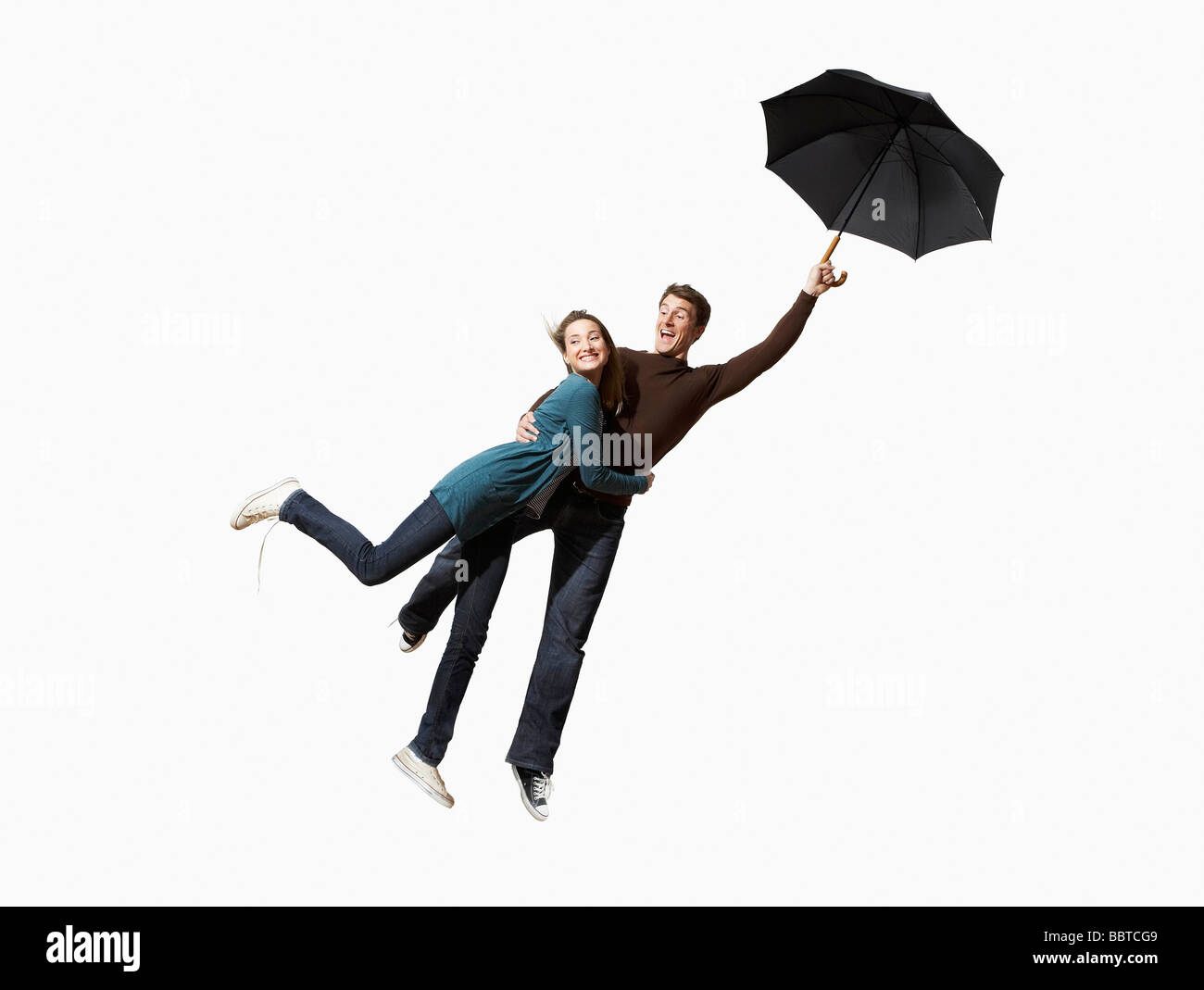 Couple being blown away - Stock Image