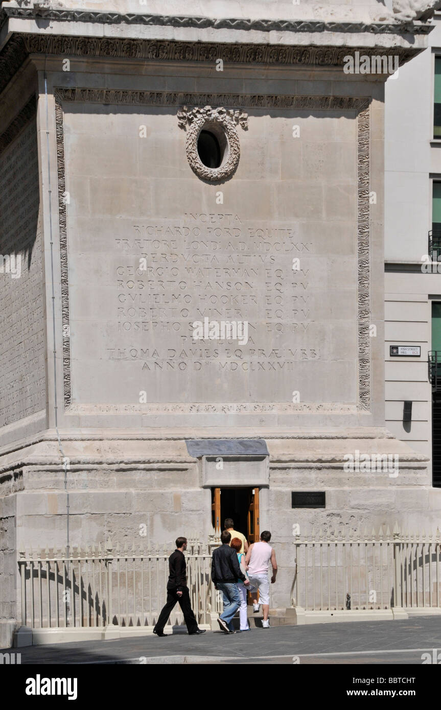 Visitors at entrance to Monument memorial column to the Great of Fire London seen after major refurbishment completed - Stock Image