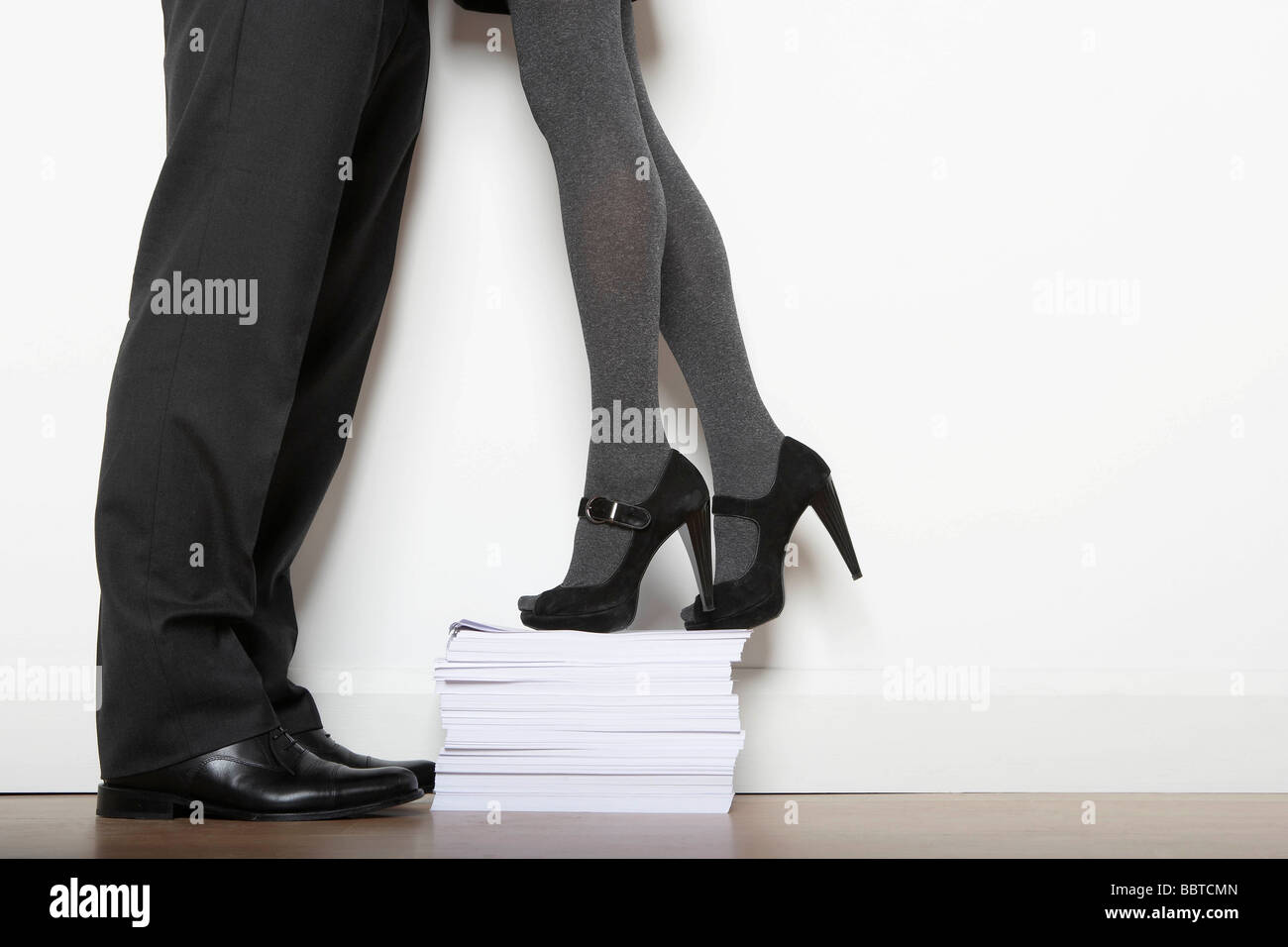 Business woman on paper pile Stock Photo