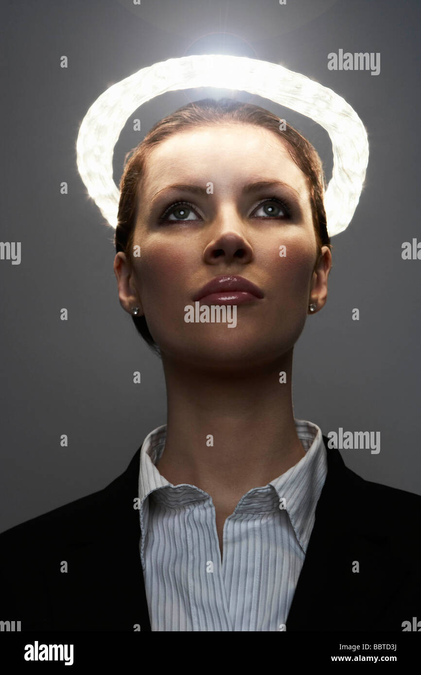 Business woman with halo - Stock Image