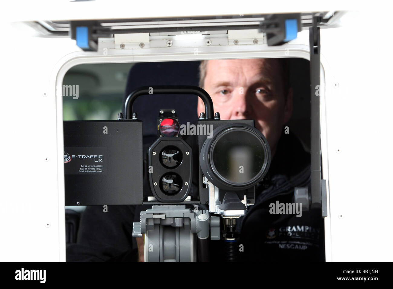 A close up view through the window of a Safety Camera van, showing the operator using a speed camera Stock Photo