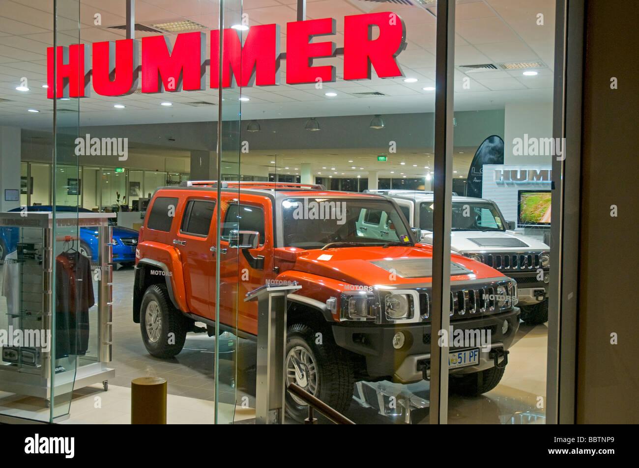 Red civilian model Hummer in showroom - Stock Image
