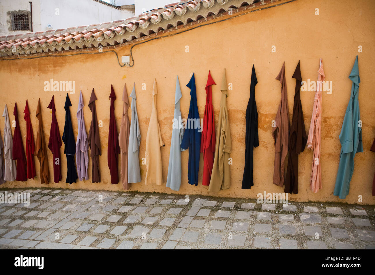 Djellaba Garments Hanging on a Wall, Chefchaouen, Morocco, North Africa - Stock Image