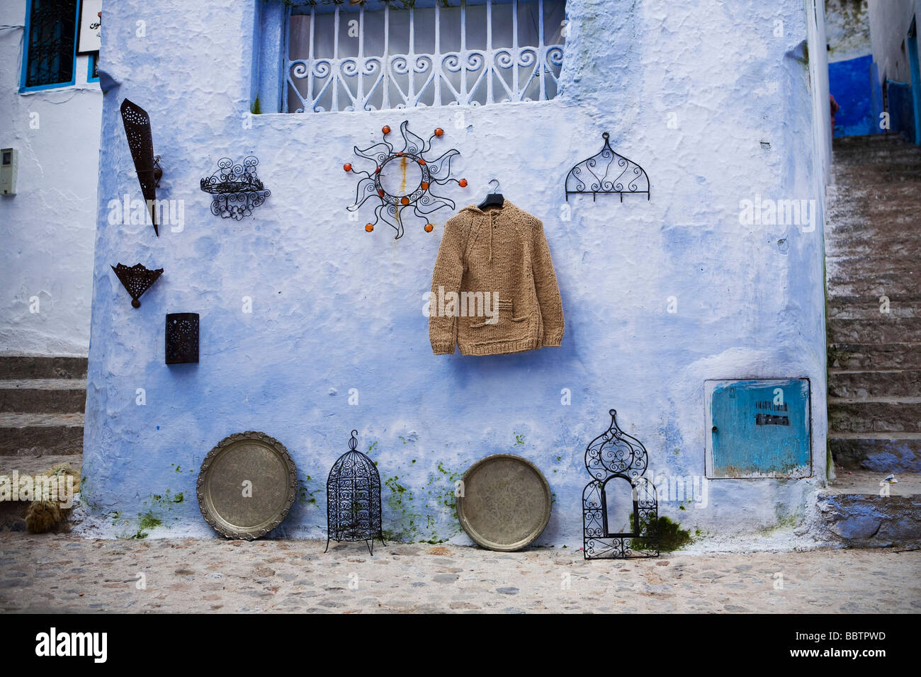 Items Hanging on a Wall, Chefchaouen, Morocco, North Africa - Stock Image