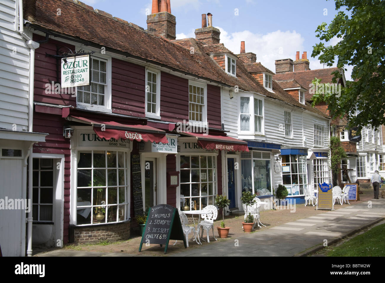 Tenterden Kent England UK May Historic white clapperboard buildings along the main street of this attractive English - Stock Image