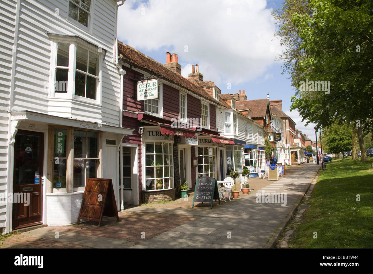 Tenterden Kent England UK May Historic white clapper board buildings tree lined main street of this attractive English - Stock Image