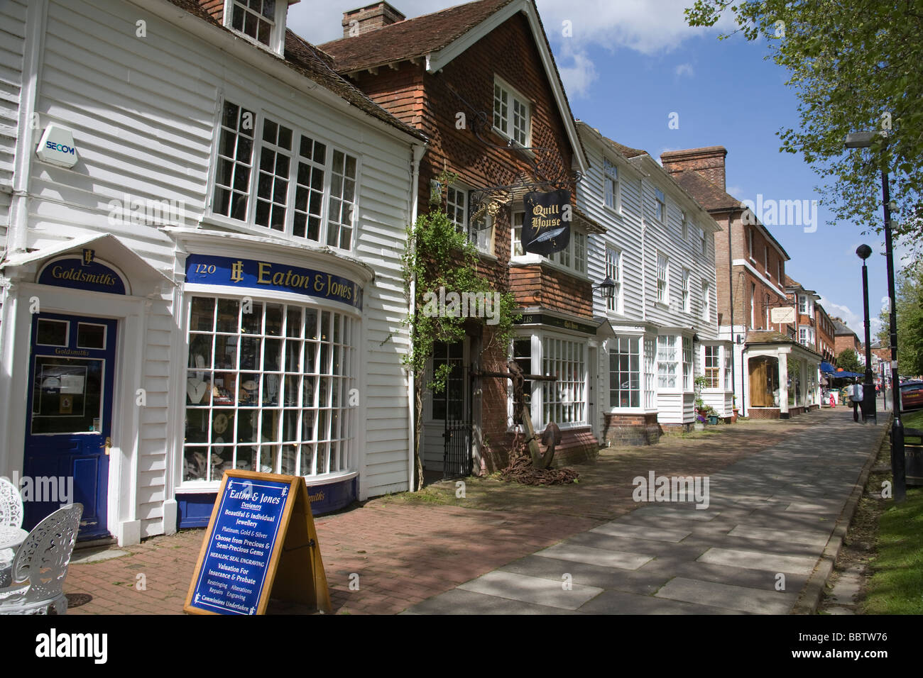 Tenterden Kent England UK May Historic buildings along the tree lined main street of this attractive English village - Stock Image