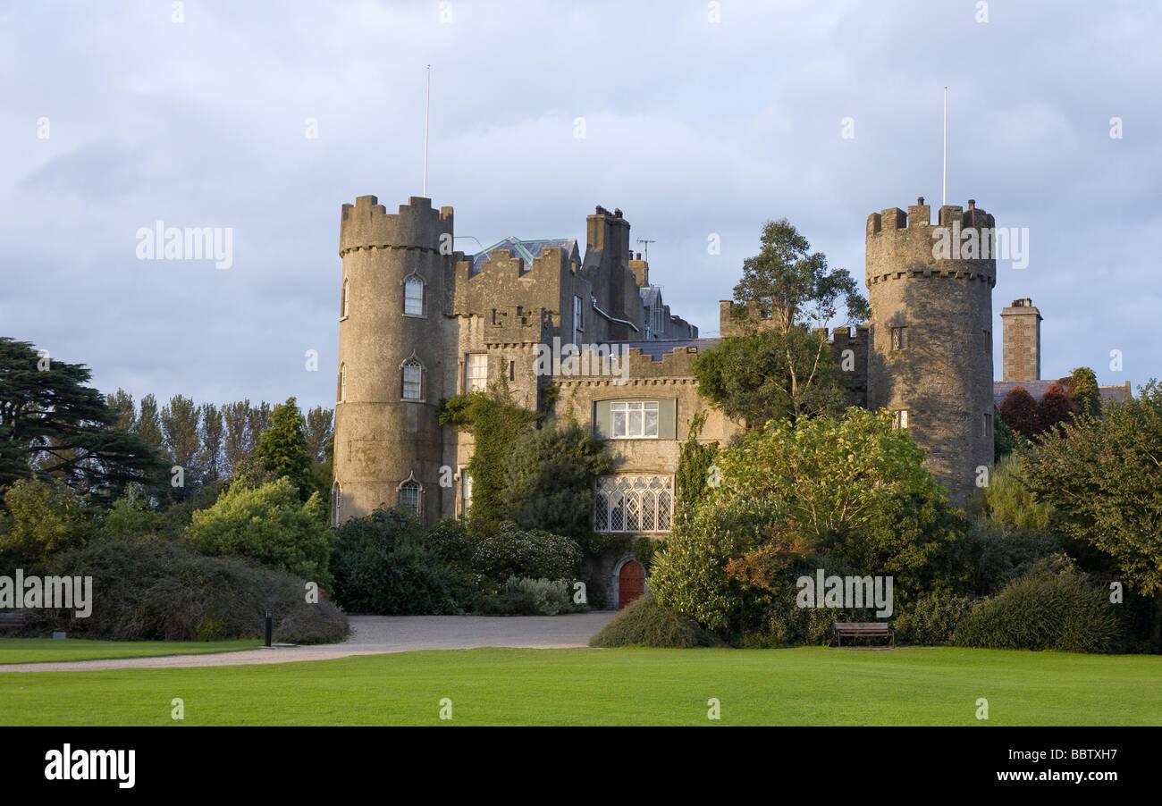 Malahide Castle at Sunset. The turreted castle at Malahide, seat of the Talbots. Malahide Castle, Malahide, Dublin, - Stock Image