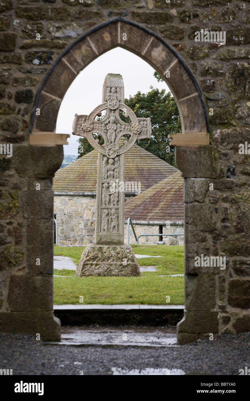 East Face of the High Cross of the Scriptures Framed by a gothic doorway. Cross of the Scriptures c908 framed by - Stock Image