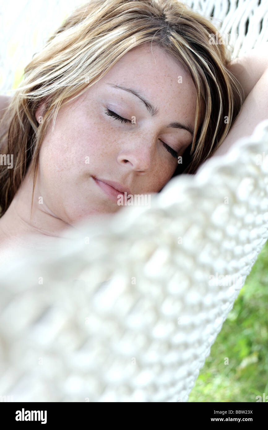 young woman in a hammock - Stock Image