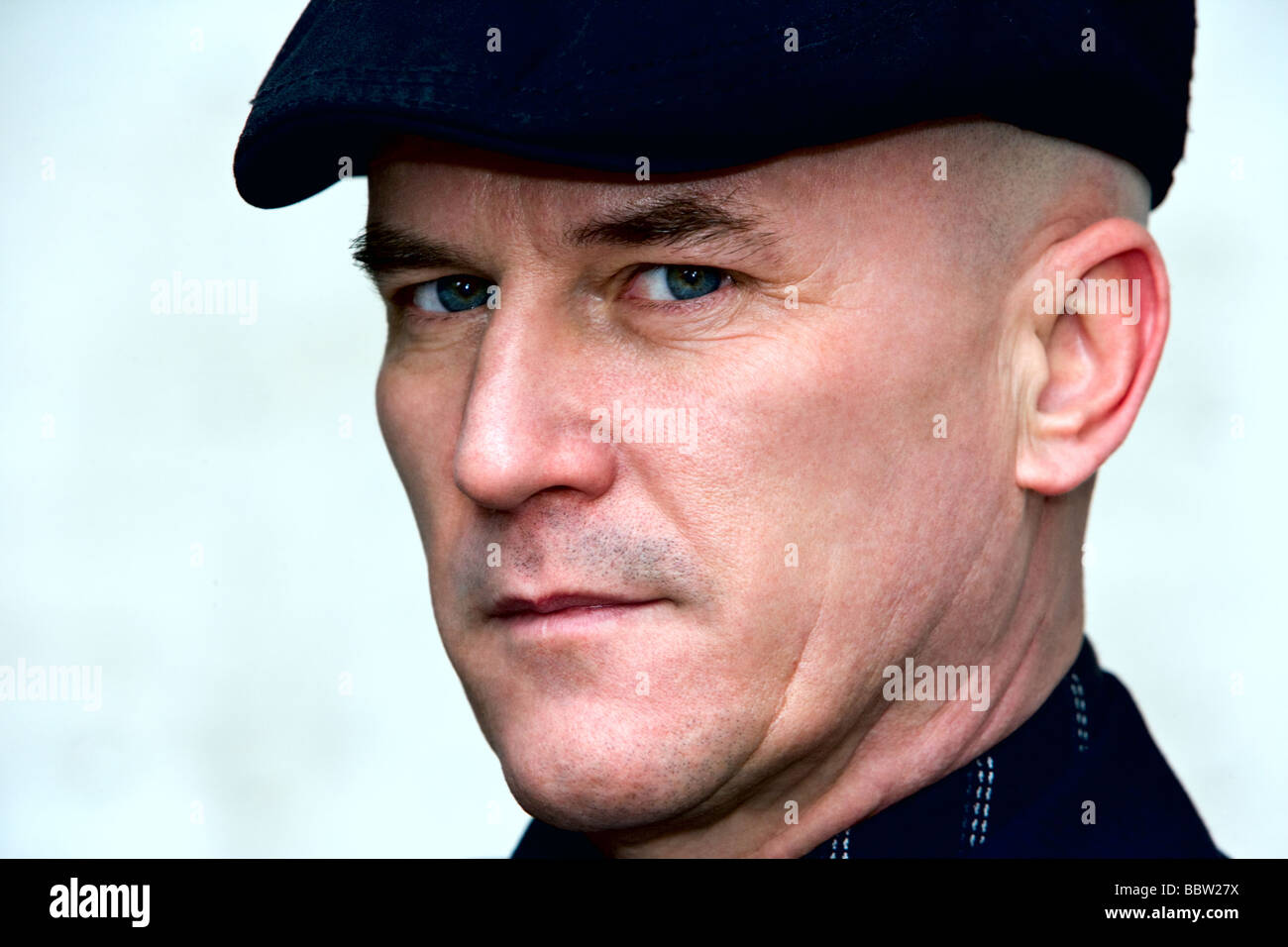 Bald man in his late 40 s wearing a dark suit and cap Stock Photo ... df3ebefadb3