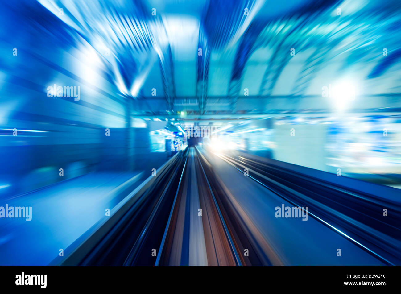 High speed train entering station platform. Focus on the rail road. - Stock Image
