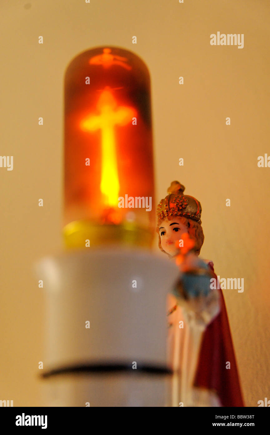 Religious home interior wall fixture Catholic icon and ever burning neon crucifix light bulb Ireland - Stock Image