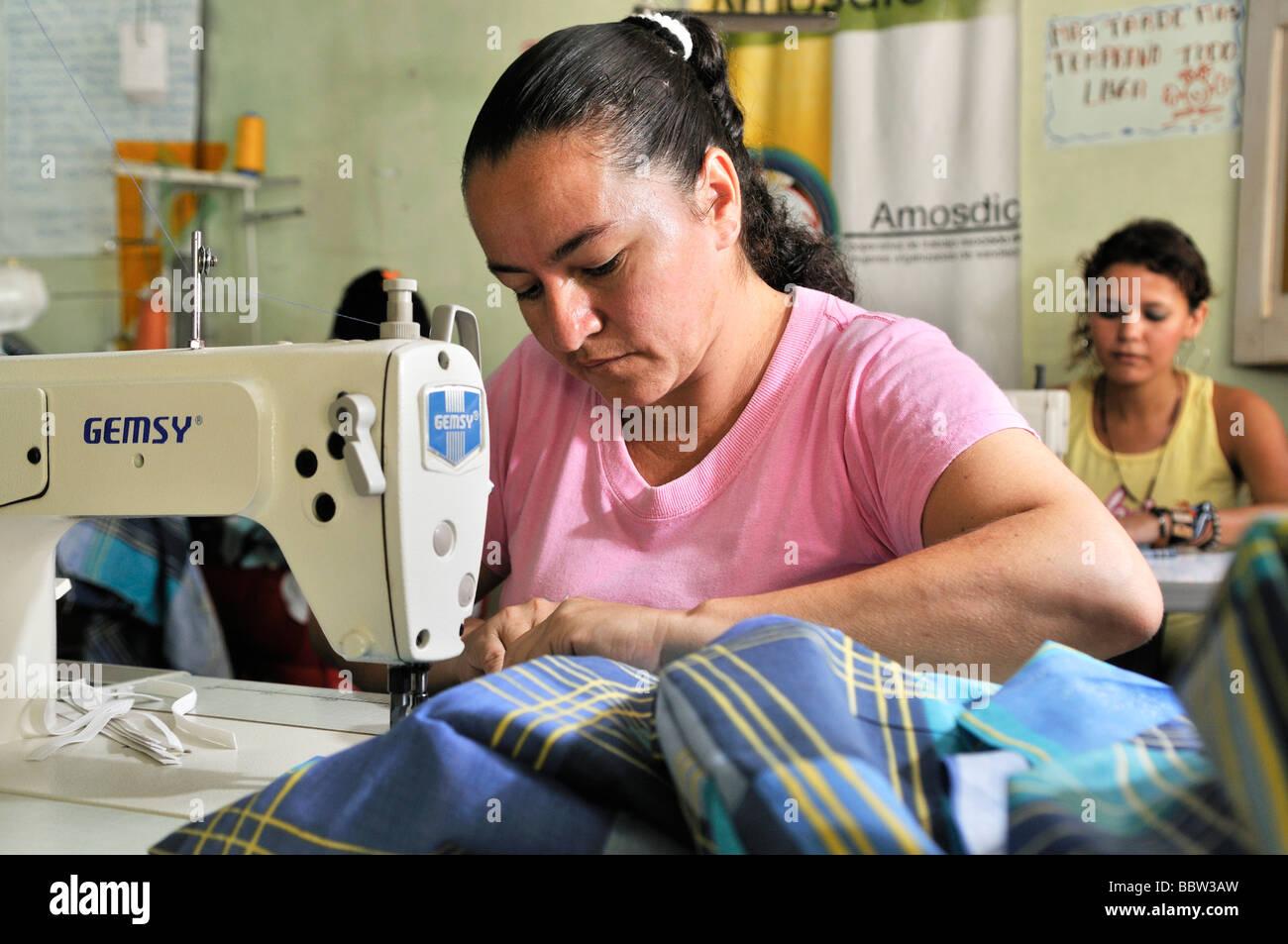 Women using sewing machines, Seamstress Cooperative in La Dorada, Colombia, South America - Stock Image