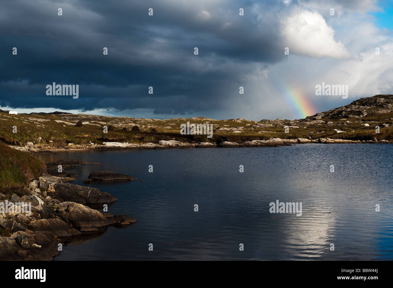 Rainbow over east coatline and loch, Isle of Harris, Outer Hebrides, Scotland Stock Photo