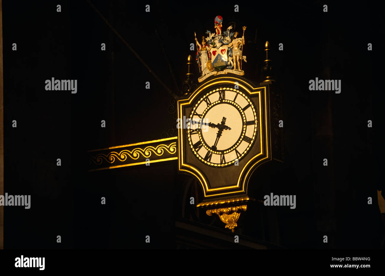 Early sun on guilded clock of 3rd Royal Exchange (1842) by Sir William Tite - Stock Image