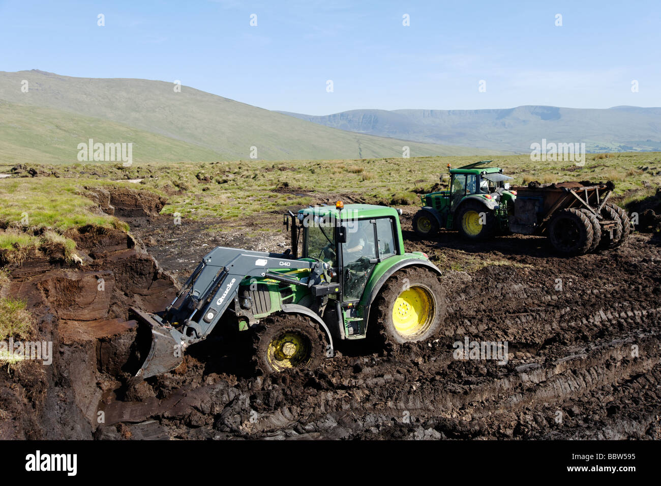 Large scale peat excavation with machinery from a bog in County Tipperary which can be used for garden centre fertiliser - Stock Image