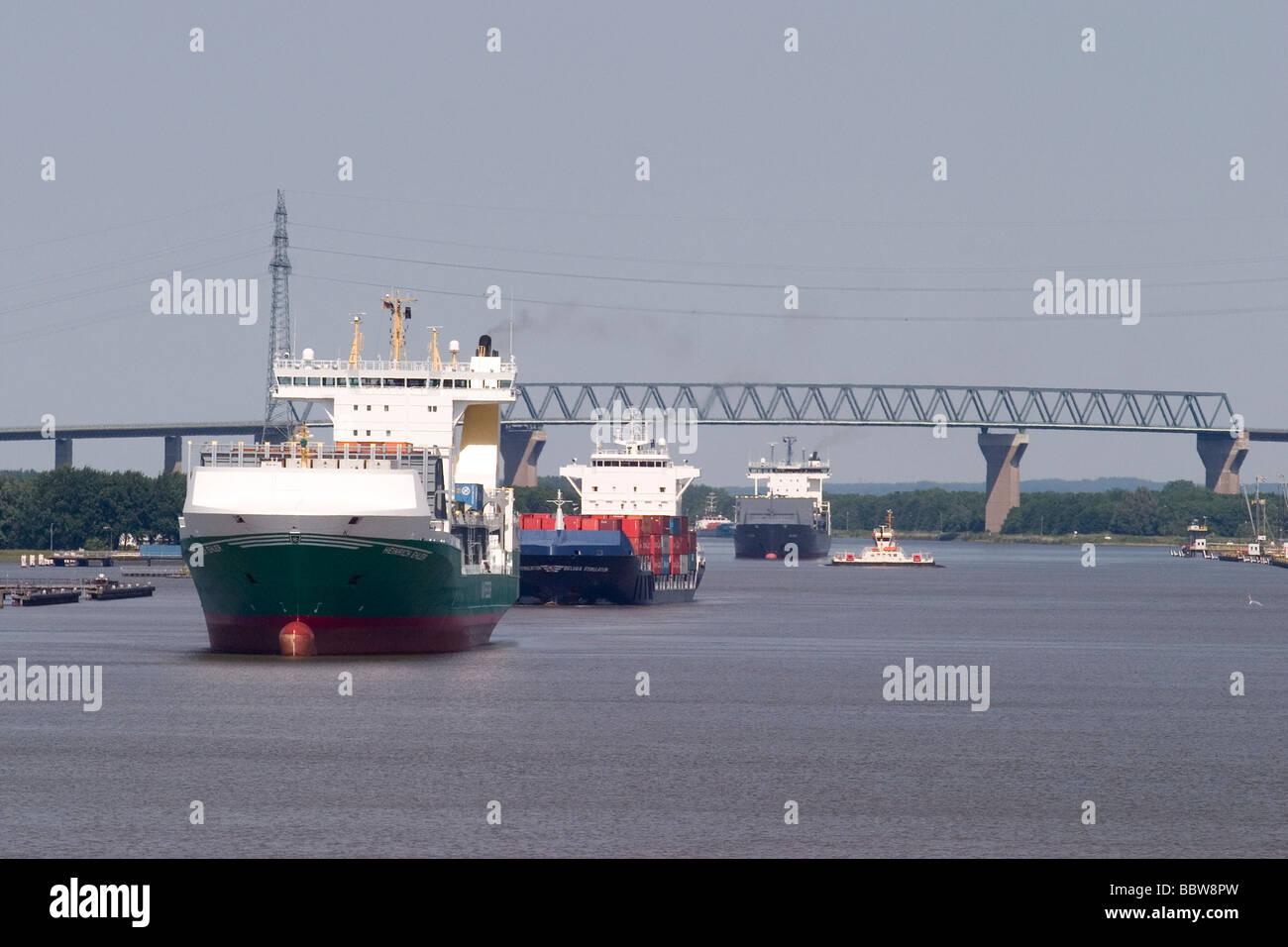 Germany Schleswig-Holstein Kiel canal, ships queue to enter Brunsbüttel lock - Stock Image