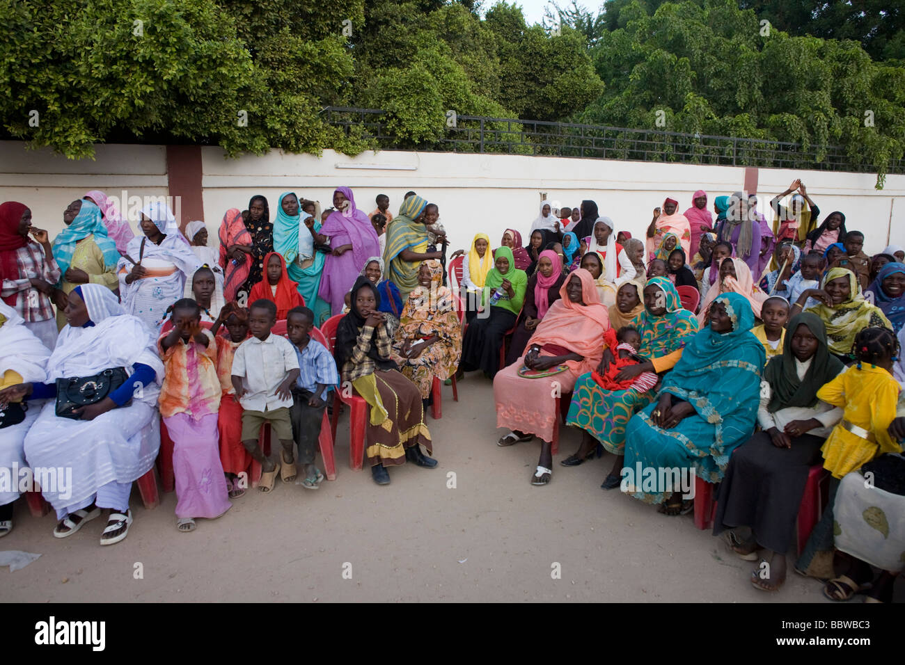 Political ladies attend womens' peace rally outside a compound tent belonging to the Governor of North Darfur - Stock Image