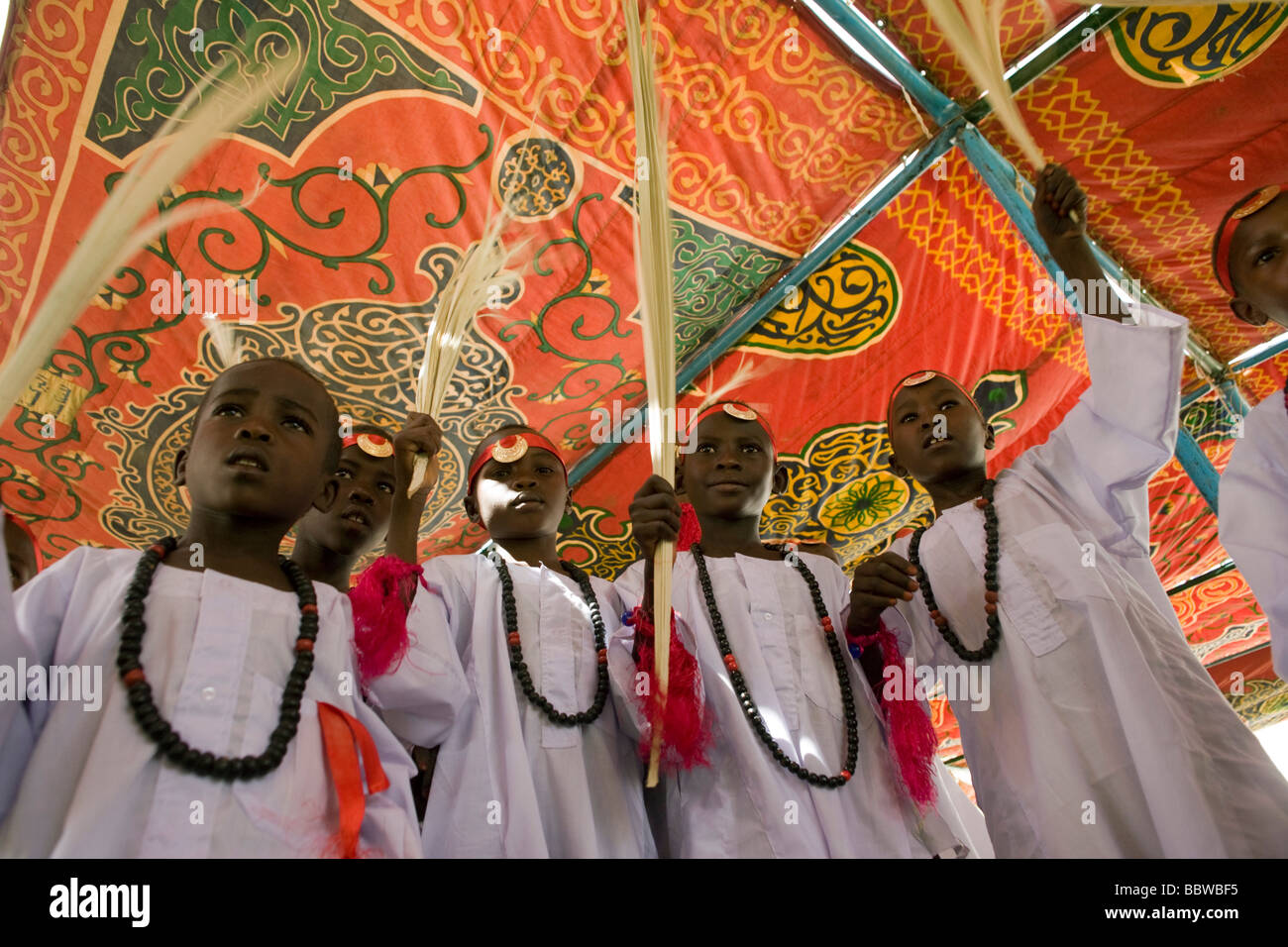 Young boys between the ages of 8 and 13 gather to celebrate a Sudanese rite of passage, the male circumcision. - Stock Image