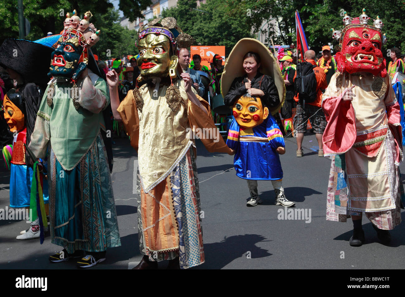 Germany Berlin Carnival of Cultures mongolians wearing masks - Stock Image