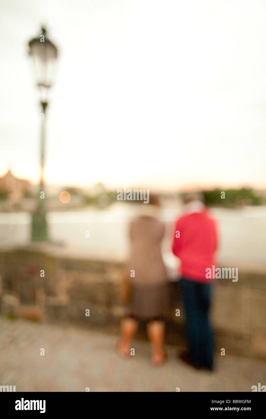 Couple standing on the charles bridge in Prague - Stock Image