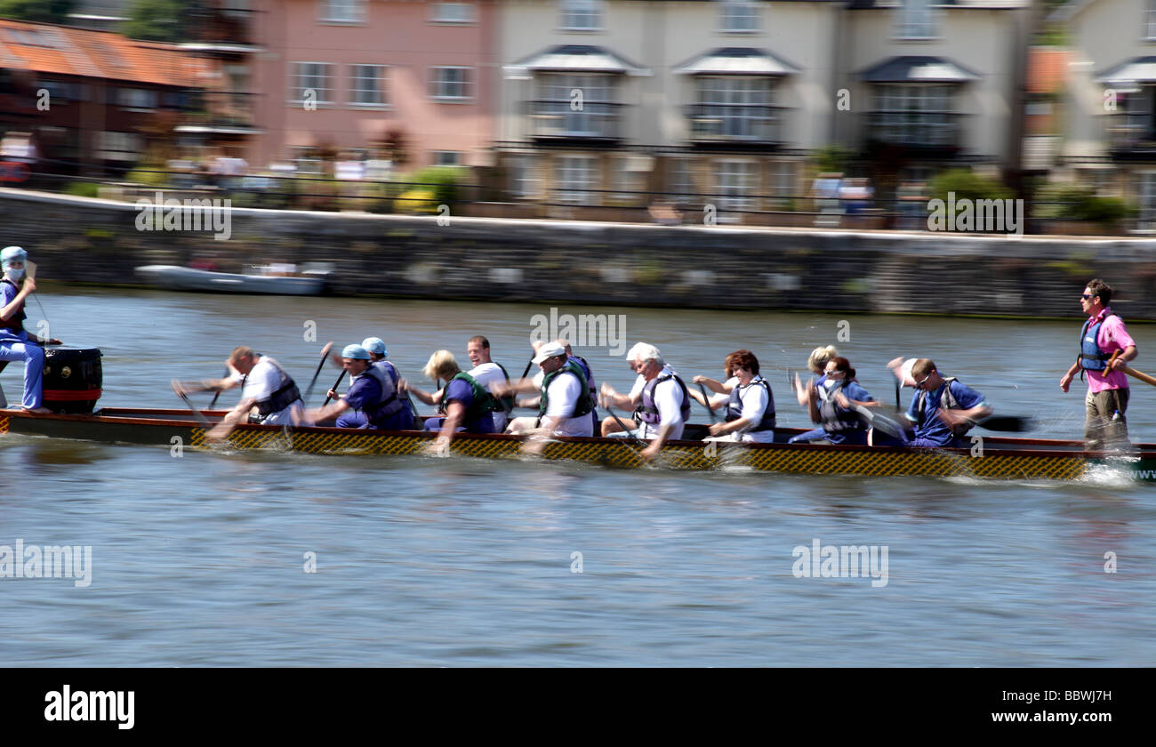 Rowers compete in The Dragon Boat Race in Bristol. - Stock Image
