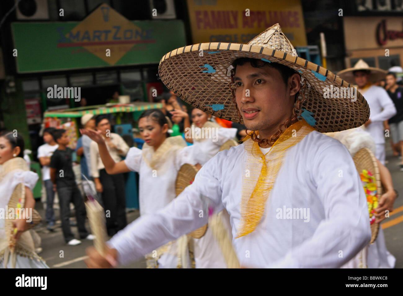 man with sinulog costume on the sinulog festival