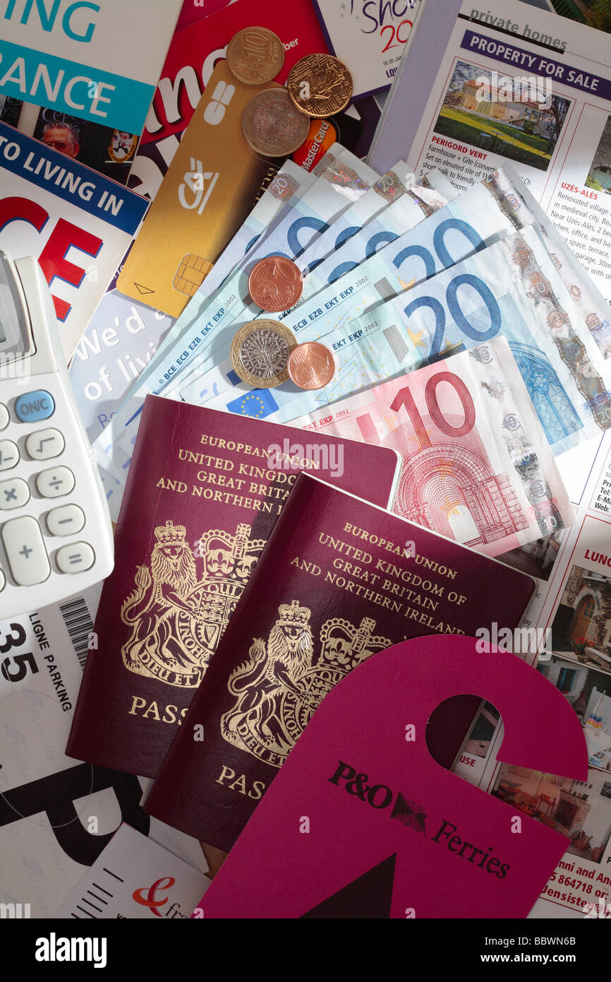 British Passports, Ferry Boarding Pass, Euros and Property Magazines illustrating Living in France. - Stock Image